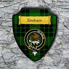 Graham Plaque with Scottish Clan Badge on Clan Tartan Background by YourCustomStuff on Etsy https://www.etsy.com/listing/512958924/graham-plaque-with-scottish-clan-badge