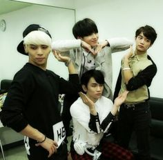 SHINee trying to make a heart shape..but seriously i dont know whats happening in this pic..ahahaha