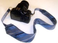 Recycled necktie camera strap
