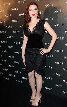 Scarlett Johansson vamps up her LBD with smoldering red lipstick.