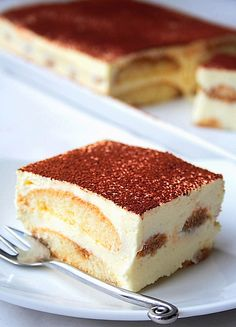 Tiramisu  2 packages of lady fingers, the soft kind Strong coffee to soak them, but not over soak 1 pint of heavy whipping cream 1 packet whip it, whipped cream stabilizer 200g of Philadelphia whipped cream cheese 150g, or as much as you like, powdered sugar 1 teaspoon pure vanilla extract About 3 tbsp cocoa powder