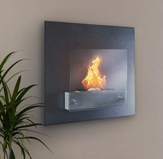 Cheap way of classing up a room and making it more modern: buying one of these fireplaces for the wall.