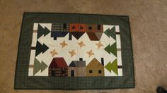 Christmas Houses Table Mat 26 x 36.  Finished and by Quiltbuilders