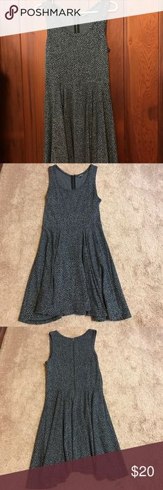 Express Grey/Black Flowy Dress Selling a gently used Express dress.  It has a pattern design both front and back with a back zipper that runs from the top to the mid way of the dress. Extremely comfy and flowy, fun dress. Made out of 73% polyester and 27% rayon.  Measures approximately 35 inches in length. Express Dresses