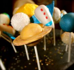 by PetiteDelightsbyMichele, via Flickr  Solar System Cake Pops with Rockets and Stars