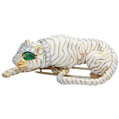 David Webb White Enamel Emerald Diamond Gold Platinum Crouching Tiger Brooch | From a unique collection of vintage brooches at https://www.1stdibs.com/jewelry/brooches/brooches/