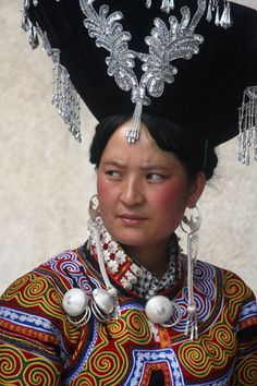 China | Yi woman with a traditional decorated hat | Puge, southern Sichuan province.| © Boris Kester