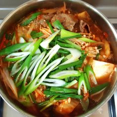 Kimchi soup using minced meat with taukwa and mushroom Kimchi soup with pork sabu sabu and glass noodle Homemade kimchi. Ing...