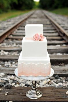 Just had to re-pin this because I couldn't get over the almost awkward placement of this cake for its photoshoot. Like, 'right...we all eat our gorgeous, and not to mention expensive, wedding cakes in the middle of railroad tracks!' While the picture's pretty, cake too of course, it's just funny looking when you think about it.
