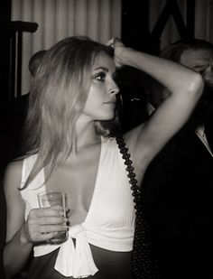 Sharon Tate, at a party