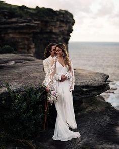 L O V E // This statement boho Rock & Romance by // ⠀⠀⠀⠀⠀⠀⠀⠀⠀ Photography by // Hair & Make Up by ⠀⠀⠀⠀⠀⠀⠀⠀⠀ . Mens Beach Wedding Attire, Boho Beach Wedding, Lace Beach Wedding Dress, Beach Wedding Photos, Elegant Wedding Dress, Wedding Dresses, Boho Bridal Hair, Bridal Hair And Makeup, Hairstyle For Wedding Day