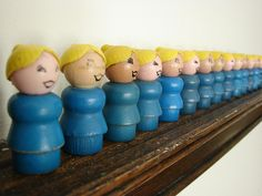 Collection of Fisher Price wooden moms (via hownowdesign's photostream on flickr).