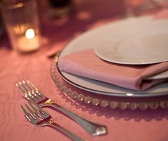 Love the charger with the pink linens and silver rimmed plates.