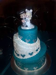 Disney wedding SOOOO Cute with the little Precious Moments as well!