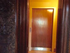 Entrance to the servants' quarters off of the main Hall of the James J. Hill House. The elevator door (really a glorified dumb waiter—uses a manual pulley system) and servants' staircase wrapped around it, is straight ahead.