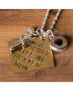 "Love it!!!! This is a brass hand stamped 1"" diamond coin with the saying ""What Doesn't Kill Me Better Run"" with a 38 caliber pendant, silver plated gun charm, and silver plated chain. This necklace is made from nickel plated 38 caliber bullets that have been tumbled clean and polished with a cloth to give a nice shine. Makes a sassy accent to any outfit. Each piece is hand cut and crafted, so there may be subtle differences than what you see in the photo such as head stamps or markings."