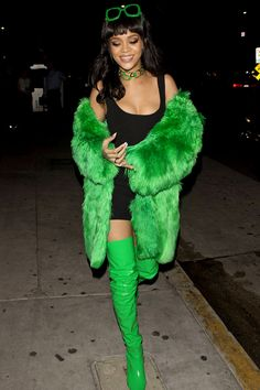 Rihanna's BITCH BETTER HAVE MY MONEY outfit: black dress + green sunglasses + green fur coat + green thigh high boots