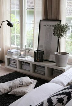 21 Ways to Make Your Living Room Seem Ginormous | Brit + - A wall console under the window.