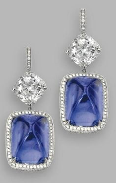 Blue Sugar Loaf Sapphire and Diamonds in a Patinum Setting  via  Sultanesque