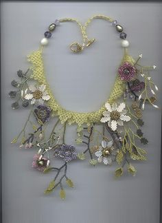 http://make-handmade.com/2011/06/28/crafty-jewelry-beaded-flowers/