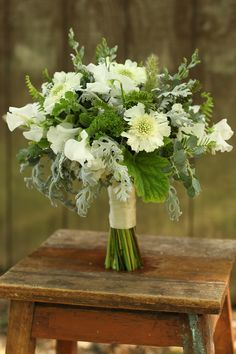 bridesmaid bouquet by wedding florist Floral Verde LLC in Cincinnati, Ohio; with white scabiosa, white Japanese sweet pea, bunny tail grass,...