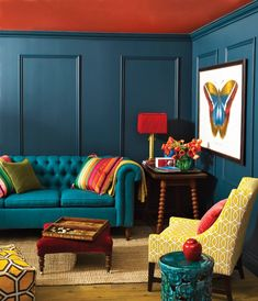 orange celing, petrol walls, turquoise couch. bold.
