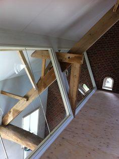 Balustrade in woonboerderij te Aarle Rixtel. Op maat gemaakt gelaagd veiligheidsglas gemonteerd door Glass4life.