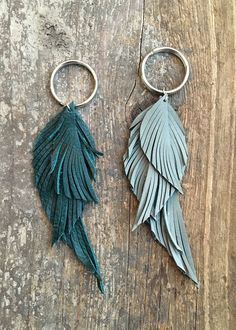Upcycled Leather Feather Keychain - approximately 4.5 - 5.5 inch length - 8 leather color choices available: black, blue, red, tan, dark grey, light grey, light pink or teal - silver split key ring
