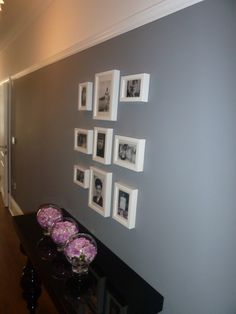 Framed photograph display above console table