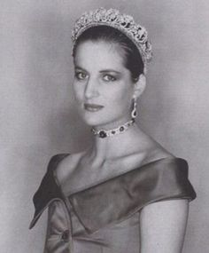 a black and white photo of Diana with her hair pulled right back, in the emerald choker and a green gown