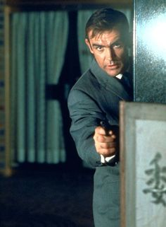 """A still from the scene where Bond escapes Osato Chemicals after stealing a top secret list that on closer inspection reveals that the company is bringing in rocket fuel. """"What is lox?"""" asks Tanaka. Bond replies """"It's an American name for smoked salmon, but  it's also the technical name for liquid oxygen, which makes rocket fuel."""""""
