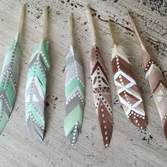"Hand painted feathers                                                                                           <span class=""buttonText"">                          More         </span>          </button>"
