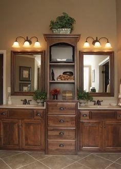 Master bath. I would put doors on the upper cabinets, and outlets hidden inside