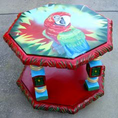 This Mexican Maccaw hexagon table is found at Antiques and Uniques of Ozona, Fl.  It sells for $135. Art by D Dunbar