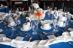 Nautical Wedding, Forked River, NJ. Latitudes on the River. Photos: Inspire Me Imagery. Navy blue, white, orange gerber daisy, prop, propeller, centerpiece, menu