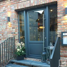 As an entrance door to a cafe, a welcoming character is very important. - As an entrance door to a cafe, a welcoming character is very important. The Doors, Entrance Doors, Front Doors, Classical Architecture, Interior Architecture, Stair Railing, Stairs, Café Exterior, Decoration Entree