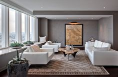 window sill Contemporary Living Room Decorators San Francisco area rug ceiling lighting dark floor gray walls houseplants live edge wood coffee table map neutral colors oversized armchairs recessed lighting succulents white armchairs white couch windowsill wood slab