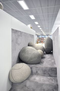 This is NOT rocks. It is big cushions, beanbag-like, resembling stones. Attractive design. The picture is from the new City Library in Stuttgart, Germany.