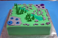 This League of Legends cake is a replica of the Summoner's rift game map. All the details were hand-made out of fondant.