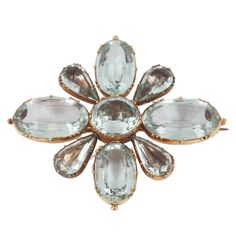 Rare Aquamarine Regency brooch. This rare brooch has 4 foiled aquamarines and 4 open back stones. c 1820