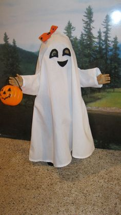 """Ghost Costume. These styles will fit most 18""""dolls like American Girl. Dolls are models not included. Your doll will be ready for the Halloween party. Includes a mini trick or treat basket for your doll. 