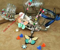 Collane farfalle, orecchini a cuore, tanto colore