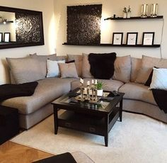 Living room decor ideas - floating wall shelves over sectional sofa.