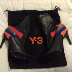 Y-3 Boots Authentic Y-3 (Adidas) Black Leather Ankle Boots with color And a hint of suede on the toe. These lovely boots have never been worn because they were purchased too small. They can be worn with the front rolled up or down. I don't have the box, but I do have the dust bag in which they're being stored. Y-3 (Adidas) Shoes Ankle Boots & Booties