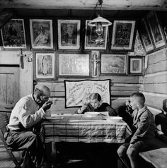 A family eating dinner in the village of Ždiar in the Tatra Mountains, Czechoslovakia, 1955.