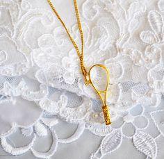 Swarovski Crystal Memories, Tennis Racket Pendant & Necklace,  Gold Tone, HALF OFF  SALE, Item No. B379 by ESTATENOW on Etsy https://www.etsy.com/listing/190387463/swarovski-crystal-memories-tennis-racket