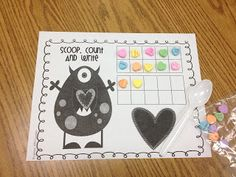 scoop, count & write.  valentine candy heart counting.