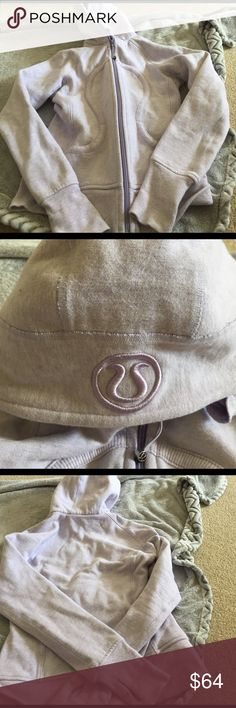 Lululemon scuba hoodie Scuba hoodie SIZE 4 in heathered lavender. Excellent condition, just wrinkled from being folded in a drawer. The Inside pilling of fleece is normal after 2 washes. I think I wore this hoodie 2 times, its just a little to stiff and snug for my liking. Minor piling and fading. lululemon athletica Jackets & Coats