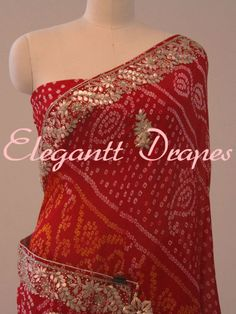 A Red Pure Crepe Rai Bandhej Gota Patti Saree wih work done on border and bootas all over the body of the saree. Comes with blouse piece. Brocade Saree, Pure Georgette Sarees, Crepe Silk Sarees, Chanderi Silk Saree, Georgette Fabric, Art Silk Sarees, Chiffon Saree, Silk Fabric, Bandhani Dress