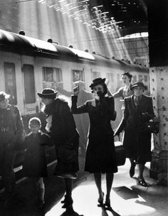 An English mother tearfully waves goodbye to her children as they are evacuated to the countryside from London's Paddington Station.
